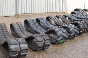 Banden en Rubber Tracks voor kranen shovels en minigravers